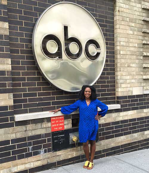Kanesha Baynard standing outside ABC Studio to appear on the Dr. Oz show